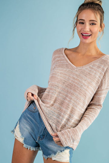 Everyday Wearable Striped Top This is a lightweight, easy fit, V neck top with as soft oatmeal color you can pair with your favorite denim.  Poly/Rayon. Model is 5'8
