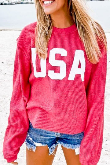 Spring Pullovers  Feeling a little patriotic in this coral ribbed USA pullover. Great for cool spring nights. Relaxed fit. Cotton/Poly Model is wearing the small.  Coral  USA Graphic Relaxed to Loose Fit Long Sleeve This Coral Ribbed USA Pullover ships FREE in 1-2wks.    being yourself is the key!