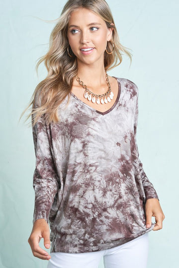 Cute & Comfy Mocha Tie Dye Throw on this mocha tie dye long sleeve tee with your favorite jeans or loungewear for an effortlessly comfy style. Rayon/Span. Model is 5'9