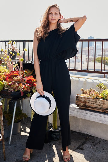 From Day To Evening Versatile Style This classic and chic one shoulder black jumpsuit can be worn day or night. Give this easy fitted jumpsuit can change vibes with a quick change of shoes from sandals to heels. Poly Knit. Model is approx 5'9.5