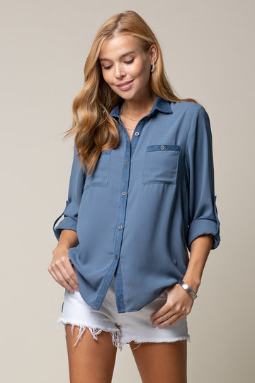 Blue Button Down Top Gorgeous transitional style with beautiful blue suede trim details on this button down top that you can wear with jeans or shorts. Poly.  Model is 5'8.5