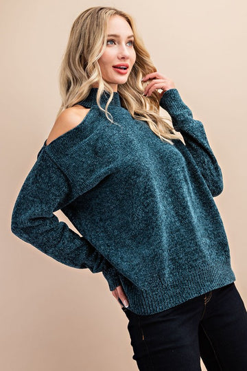 Chenille Feels! This incredibly soft and chenille like teal sweater has a flirty single cold shoulder that makes this top a day to night favorite! Relaxed fit. Poly. Model is 5'8