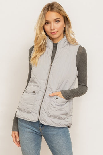 Faux Fur Lined Zipper Vest Be prepared for that first cold front with this quilted padded zipper vest. Choose from Soft Gray or Light Blush! Both great colors that go with almost all your color combos in that closet! Poly/ Model is 5'9