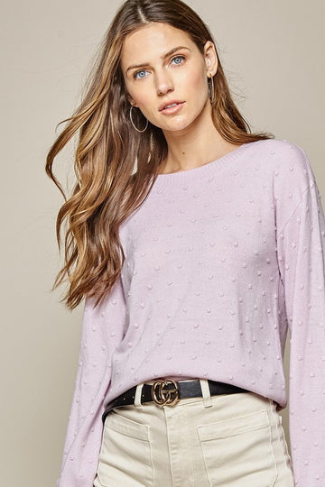Lovely Lavender With Character! This lightweight pull over sweater is a beautiful lavender color with textured polka dots. Pairs perfectly with jeans, slacks and more for a work or play approved look! Poly. Model is approx 5'9