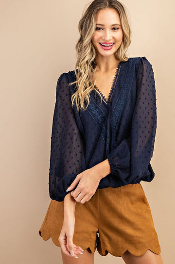 Lovely Details For Work & Play This versatile navy and lacy surplice top will take you from day to night style effortlessly! Poly. Model is 5'8