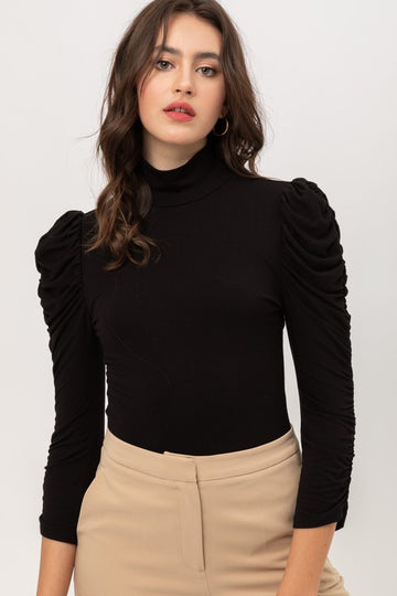 Beautiful Bodysuit With Style Throw this gorgeous bodysuit on with your favorite jeans, slacks and pants with ruched sleeves and mock neck turtleneck. Fitted Style. Rayon/Span. Model is 5'9