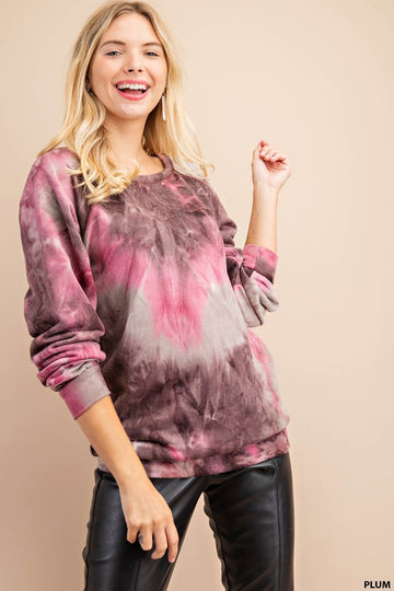 Soft and Plum Tie Dye Top Whether your are lounging at home or running errands this soft and comfy raglan tie dye top pairs perfect with your jeans, leggings or joggers! Poly. Model is 5'7