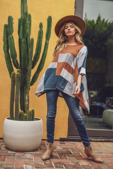 Fall Color Block Poncho Top! Throw on this color block rust and teal poncho with your jeans or leggings for a Autumn day worthy attire. Loose fit. Knit. Model is 5'7