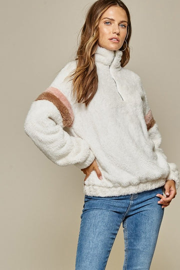 Stay Warm In This Cozy Shearling Pullover Get ready for Fall with Latte's and cozy fireside chats in this soft and cute mock neck zip up pullover! Relaxed fit. Poly. Model is approx 5'9