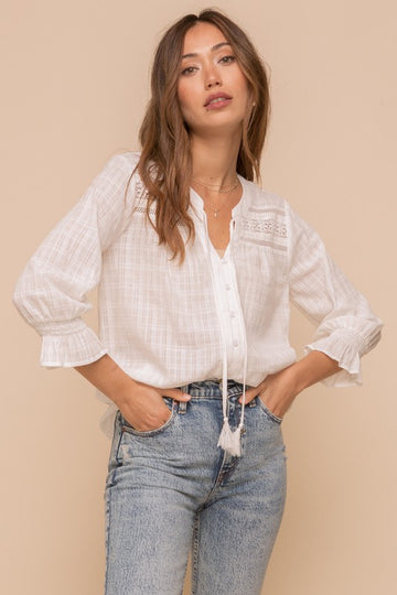 Fresh Style Ivory Top This light and lovely relaxed fit top is perfect with your favorite denim for summer into fall style. Lace and Tassel details make this a better than basic top. Cotton. Model is 5'8