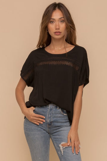 Better Than Basic Lace Detail Top This effortlessly cute top takes a black tee to the next level! Beautiful lace detail and relaxed fit makes this an easy to throw on anytime top! Rayon. Model is 5'8