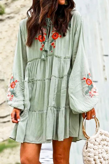 Chic Boho Babe Style This lovely embroidery and lace detailed dress has a loose and flowy fit with on point bubble sleeves and tassel details. Cotton/Poly. Loose fit. Model is wearing a small.  Embroidered Flowers Tassel Neck Puff Sleeves Ruffle Style Loose Fit Sage Color This Sage Boho Embroidered Dress ships FREE in 1 week.  being yourself is the key!