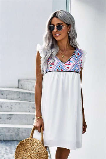 White & Color Combo Dress This absolutely lovely boho bust dress has chic flutter sleeves and a flattering babydoll style that makes this dress an everyday wearable and pretty enough for banquets, graduations, showers and more. Poly/Span. Model is 5'9