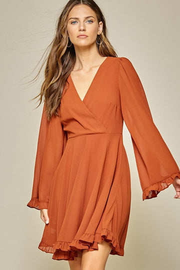 Fall Colorful Bell Sleeve Dress Be Fall ready in this lovely surplice fit and flare rust bell sleeve dress! From work to play and day to night events this dress is a Fall must have! Poly. Model is approx 5'9