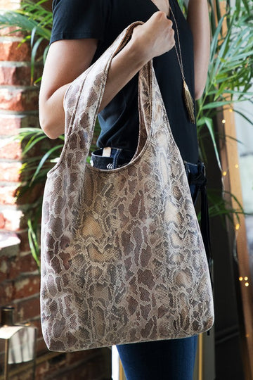 Cool Tote. Chic Style! This chic snake skin tote will add a little pop of pattern to your everyday attire. Accessorize in style! Soft and easy to carry. Room for all your goodies!   14