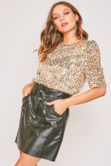 Party Perfection! Put on something special! This puff shoulder gold sequin top has a relaxed fit that pairs perfectly with jeans and beyond! Relaxed fit. Poly. Model is approx 5'9