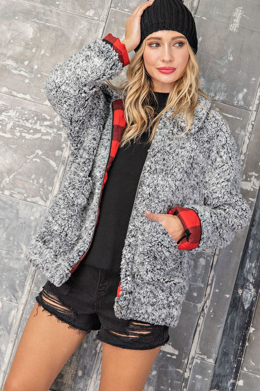 Keep Warm in Cool Styles This Sherpa Harrington style jacket has a cool buffalo plaid lining and comfy relaxed fit to keep you warm this winter! Poly. Model is 5'8