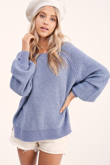 Lightweight For Fall  This gorgeous blue exposed stitched knit sweater pairs with all your favorite denim and shorts for an effortless and relaxed Fall style. Polymide. Model is approx 5'8