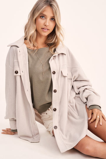 Upgrade Your Outerwear! Perfect for layering up over your active wear or everyday street style! This lightweight fleece button up jacket is seriously soft and comfy! Poly. Model is approx 5'8