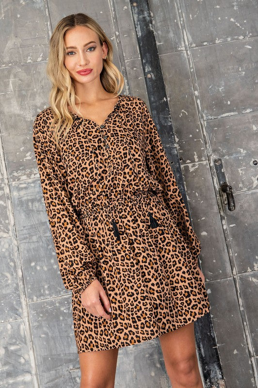 Work & Play Leopard Tassel Dress! A work approved, play approved and date night approved leopard print dress that has an elastic waist and tassel details at the neck. Beautiful billow sleeves for a flowy and classic fit. Rayon. Model is 5'8