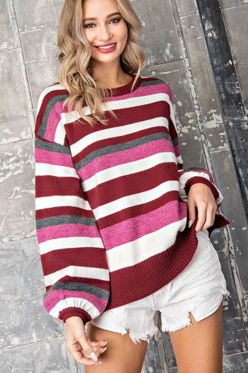 Bubble Sleeve Sweater Style Get your cute casual look elevated with this berry and wine toned striped sweater. Bubble sleeves and relaxed fit makes this a perfect pairing with all your denim! Acrylic/Poly/Nylon. Model is 5'8