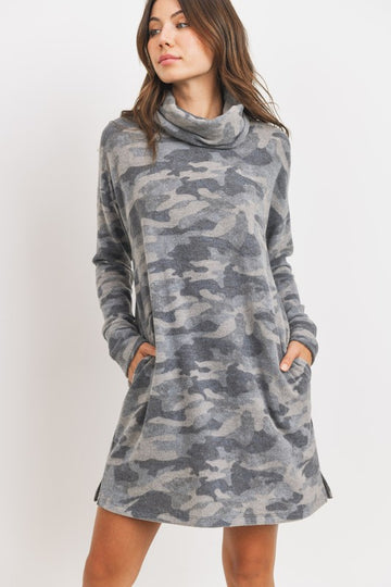 Soft Turtleneck Camo Cuteness Cute and comfy is what this brushed knit camo turtleneck dress is all about. Incredibly soft and nice and roomy! Plus Pockets! YES!! Poly/Rayon/Span. Model is 5'9