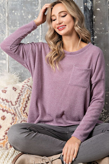Everyday Wearable Top! This loose fit top pairs great with your leggings and denim. A loose fit with a front pocket and a colorful addition to your wardrobe. Poly/Rayon/Span.  Loose Fit Long Sleeve Pocket Front Rounded Hi-Lo Hem This Lovely Lilac Easy Fit Top ships FREE in 1 week.  being yourself is the key!
