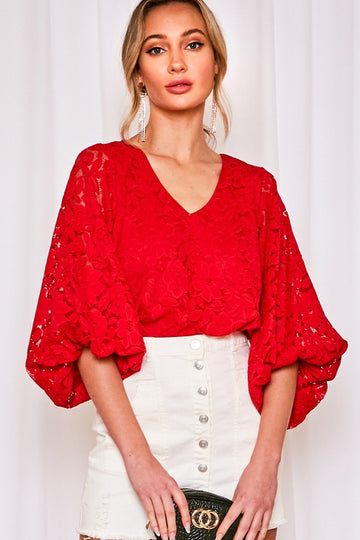 Lovely Lace This beautiful red lace top has as relaxed fit and on point bubble sleeve details that make it a top for everyday and special enough for that fun evening out! Rayon. Model is 5'9