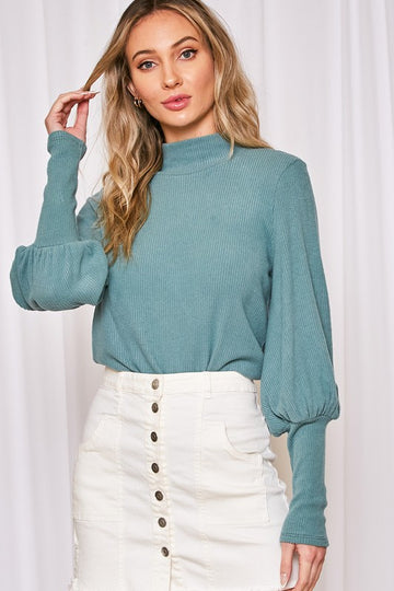 Those Sleeves! This everyday wearable top will take you from errands, to work, date night and beyond! A versatile soft relaxed fit top for anytime! Poly/Span. Model is approx 5'9