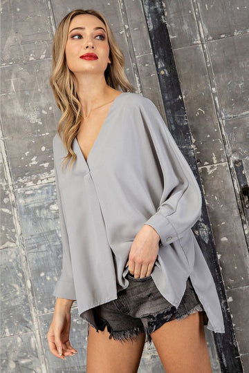 From Work To Play! Whether running around town or working from home or office, you will have that clean and chic look. This gorgeous blouse has 3/4 button cuff sleeves and a side slit hem that makes it easy to wear out or perfect for a French tuck in your favorite denim. Flowy fit. Poly. Model is 5'9