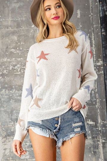 Lightweight Star Style! This lovely off white ribbed knit colorblock star sweater will be a multi seasonal worthy top! Relaxed fit. Poly. Model is approx 5'8