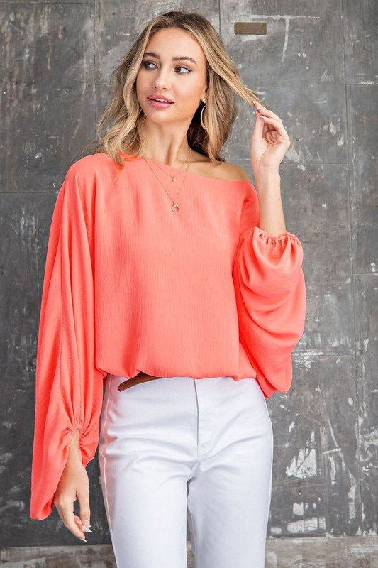 Colorful Spring Top! Freshen up that pre spring style with this chic melon boat neck top! Pairs perfectlky with a pair of white, black or blue denim for super versatile looks! Model is 5'9