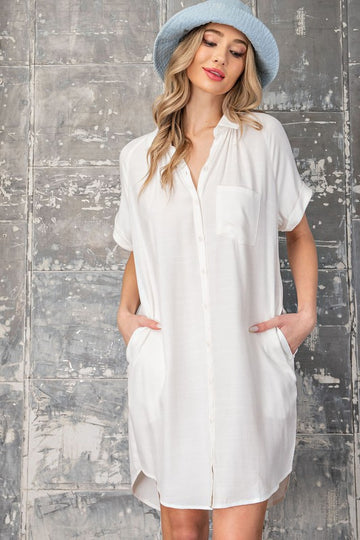 Easy Breezy Dress An effortlessly chic off white dress with button down details and pockets! Relaxed fit. Cotton/Poly. Model is 5'8