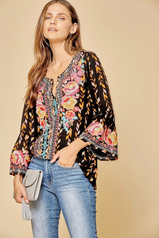 Cool Pattern & Awesome Details A gorgeous top with stunning pattern and floral embroidery that makes this a head turner. Great for casual style, work style and more. Pair it with jeans, shorts or slacks for great versatility! Relaxed Fit. Rayon. Model is 5'9