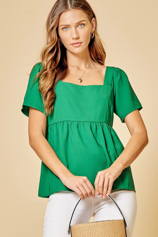 Spring Green! A fresh fun top that you can throw on anytime for a cute spring casual style! Relaxed fit. Poly. Model is 5'9
