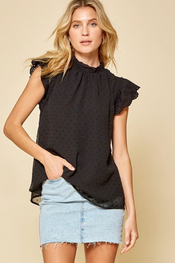 Lace & Lovely Black Top A versatile top from day to night! This lovely top features ruffle lace short sleeves and swiss dot bodice. Relaxed fit. Poly. Model is 5'9