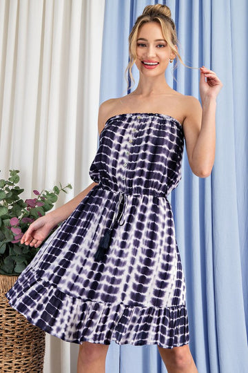From Patio to Party Sun Dress Show off those sun kissed shoulders in this pretty navy tie dye dress with cinched waist and ruffle bottom details. Rayon. Model is 5'8