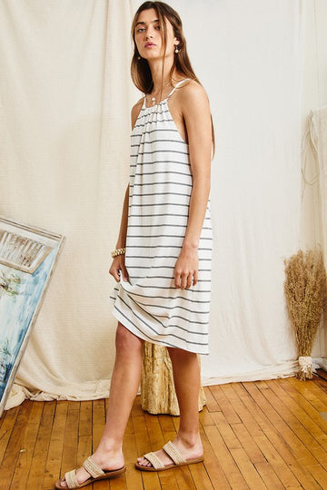 Fresh Summer Style An everyday wearable dress that you will love to wear when home and on vacation! Easy to pack and easy to pair with sandals and wedges. Poly/Rayon/Span. Model is 5'9