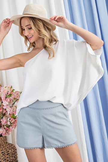 Stunning Chic One Shoulder Style Chic & sophisticated style when paired with jeans or shorts! This is  a beautiful one shoulder flow top. Loose fit. Poly. Model is approx 5'8