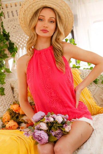 Feminine & Fabulous A pop of pink makes this high neck lace tie back top a show stopper. Goes great with shorts or jeans! Relaxed fit. Poly. Model is 5'9