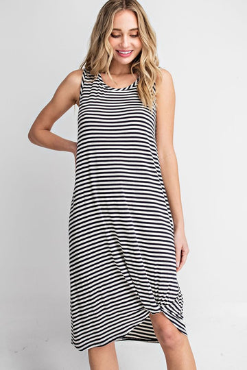 This black and white tank dress has an easy fit with a bottom twist hem detail and a midi length. Great for casual around the house vibes, throwing on over your swimsuit, or running some quick errands in warm weather! Rayon/Span. Model is 5'8