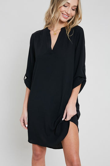 Roll Tab Sleeve Black Dress Whether headed back into work or taking those Zoom meetings, this shirt dress with flattering rounded hem and roll tab sleeves is a classic your closet will thank you for! Year round wearable! Poly/Span. Model is 5'9