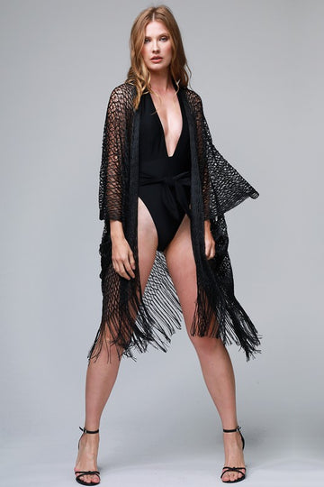 Gorgeous Net Fringe Kimono Sleek and sophisticated! This black net kimono can be thrown over your swimsuit a pair of shorts and tee and even a dress for little shoulder coverage.  Stunning and sheer. Poly. Model is 5'9