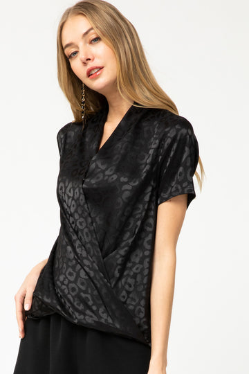 Satin Drape Chic Top This sleek and sophisticated black on black leopard print top is a chic addition to your closet. Pair this stunning top with shorts, jeans and slacks for a work to evening style. Poly. Model is 5'8