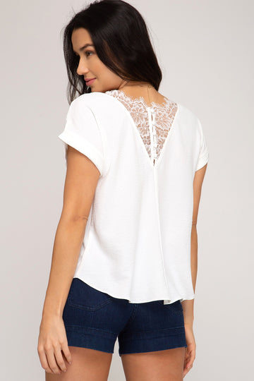 Lace & Button Back Details Lovely Lace and Button Details make this top a head turner! Stand out when you wear it! Pair it with jeans or shorts for a elevated classic style. Poly. Model is 5'9