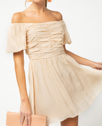 On or off Shoulder Peach Dress From day to evening this on/off shoulder dress is a fresh breath of air in this pretty light peach color. Poly. Model is 5'9.5