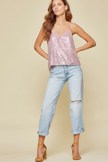 Girls Night Out Approved! This fun and flirty V Neck pink sequin top is a great layering piece or worn alone. Relaxed Fit. Poly. Model is 5'9