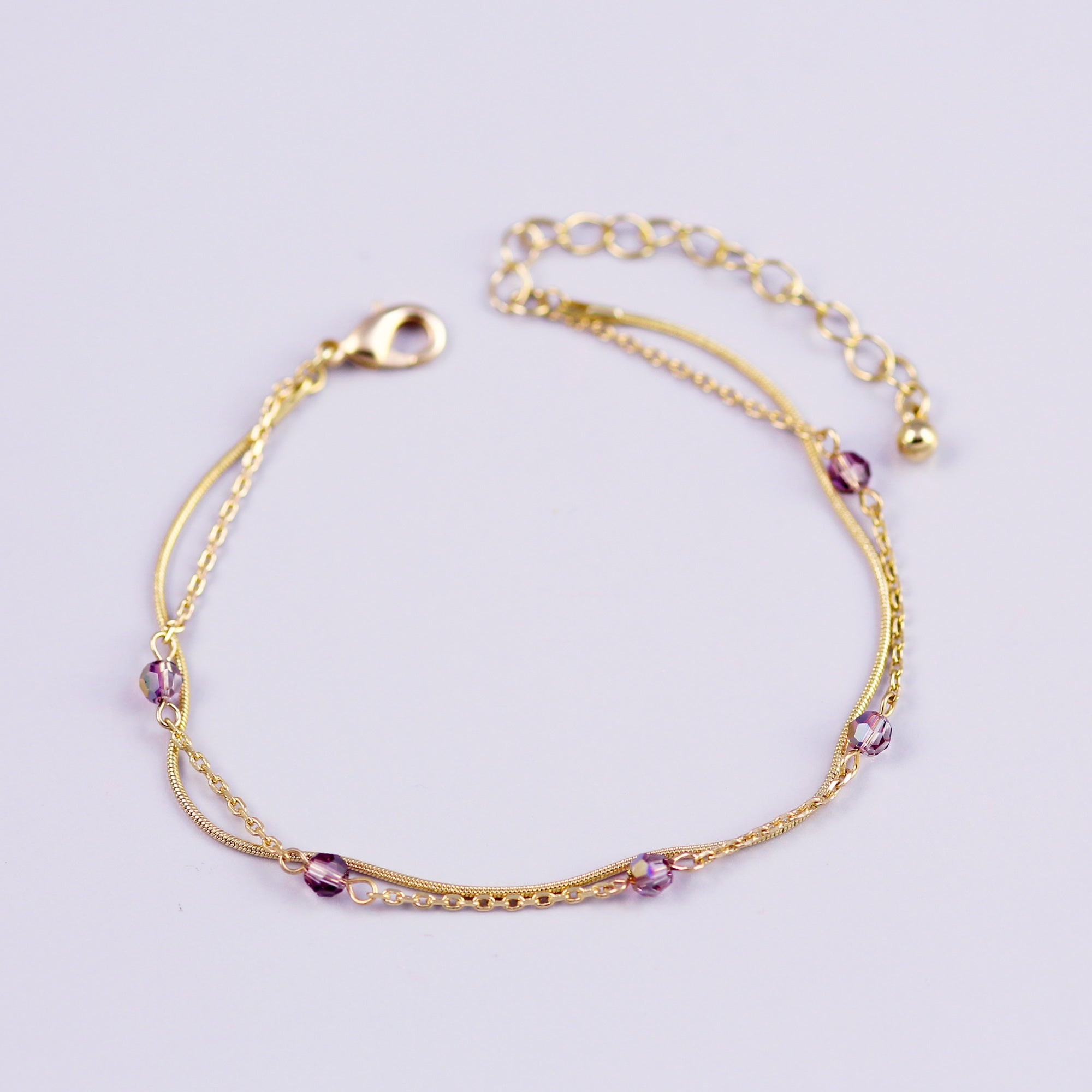 Delicate Gold Bracelet with Light Amethyst Crystals