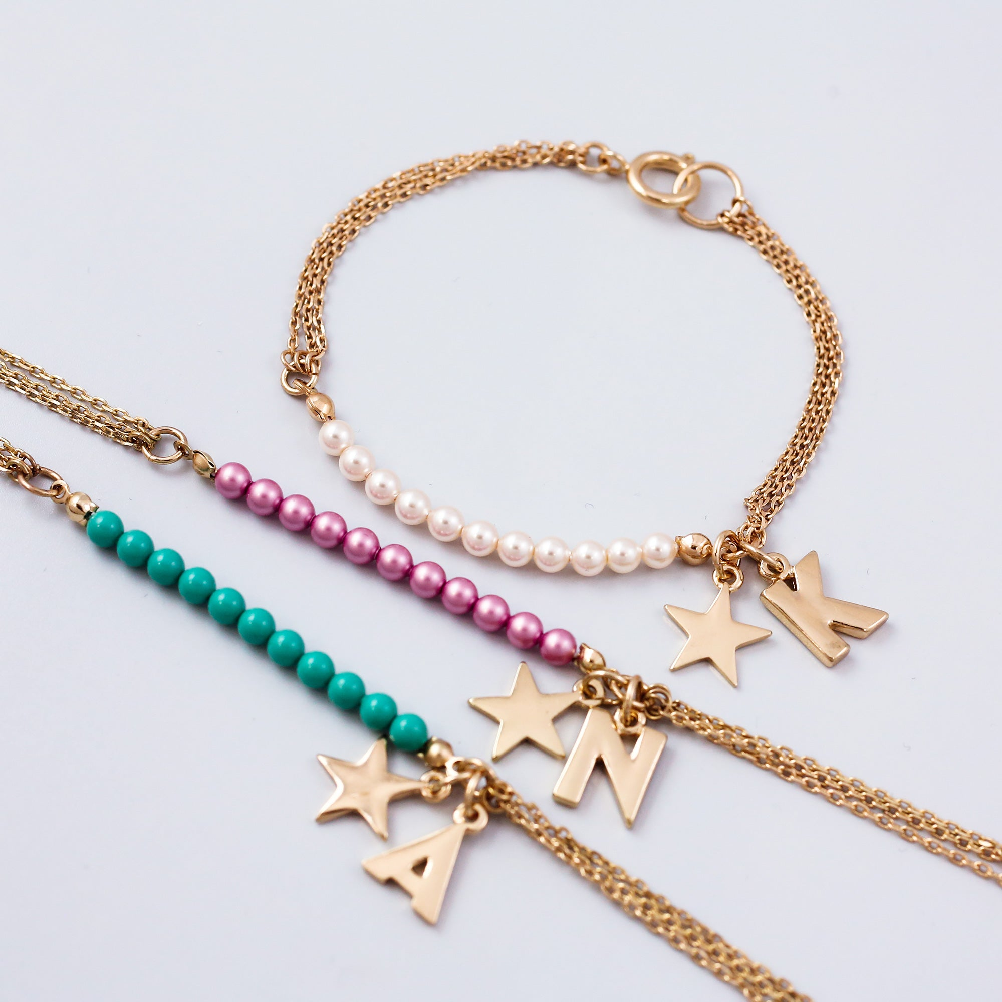 Personalised Gold Charm Bracelet Made with Pearls from Swarovski ®