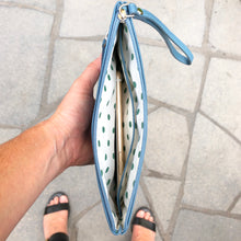 milly clutch wallet with hand strap in cadet blue instagram image